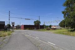 A swedish railroad crossing. A railroad crossing in Veddige, a small town in western Sweden Stock Images