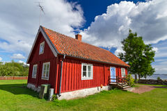 Swedish red cottage house Stock Images