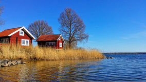 Swedish Red House. On the seaside. Color of Spring of one of Swedish Archipelago Stock Image