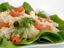 Swedish salad. Made of rice and smoked salmon Stock Image