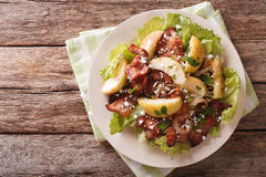 Swedish salad with fried bacon, green apple and goat cheese. Hor. Swedish salad with fried bacon, green apple and goat cheese on a plate. Horizontal view from Stock Photo