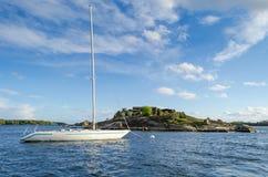 Swedish sea archipelago with sailboat. Idyllic landscape for Swedish sea skerries Royalty Free Stock Images