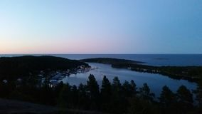 Swedish sea and forest summernight royalty free stock photos