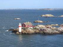 Swedish skerry. Small lighthouse on a skerry Royalty Free Stock Photo