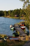 Swedish summer. Place , red house , boats in the lake Royalty Free Stock Photos