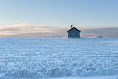 Swedish summer-house in winter. Traditional swedish summer house set in a snow covered oat field, the island of Frösön, Östersund, Sweden stock image