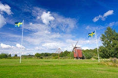 Swedish summer scenery. Summer field with Swedish national symbols royalty free stock image