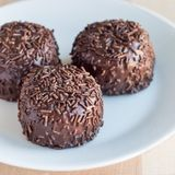 Swedish sweets Arrack balls, made from cookie crumbs, cocoa, but. Ter and coconut wine Arrack flavour, square format Stock Image