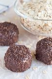 Swedish sweets Arrack balls, made from cookie crumbs, cocoa, but. Ter and coconut wine Arrack flavour, on a wooden table, vertical Stock Photography