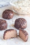 Swedish sweets Arrack balls, made from cookie crumbs, cocoa, but. Ter and coconut wine Arrack flavour, on wooden table, vertical Royalty Free Stock Photos