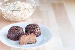 Swedish sweets Arrack balls, made from cookie crumbs, cocoa, but. Ter and coconut wine Arrack flavour, horizontal copy space Stock Photos