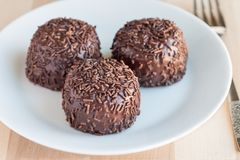 Swedish sweets Arrack balls, made from cookie crumbs, cocoa, but. Ter and coconut wine Arrack flavour, on wooden table, horizontal Royalty Free Stock Photography