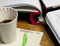 Swedish tax declaration. Form on a table filled with papers, folders and a cup of coffe Royalty Free Stock Photography