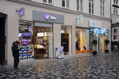 SWEDISH TELIA  AND NORWEGIAN TELENOR. Copenhagen / Denmark_ 18th. November 2016 _Contender Swedish telia and Norwegain Telenor telepone providers on Kobmagergade Royalty Free Stock Photography