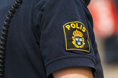Swedish textile police badge. On officers summer uniform royalty free stock photo