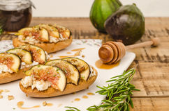 Swedish toasts with figs, cheese, rosemary, honey and walnuts Royalty Free Stock Image