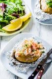 Swedish topped backed potato with shrimp royalty free stock image