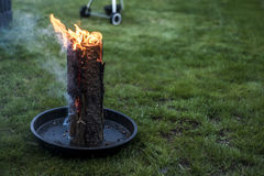 Swedish torch fire burning stub on plate for rest or to cook food chill mood Royalty Free Stock Photos