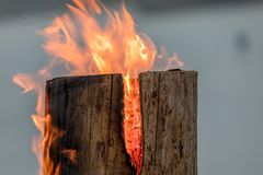 Swedish torch fire burning stub on plate for rest and for warming in winter. On the mountain stock photo