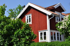 Swedish traditional house. A traditional red and white Swedish wood house stock image