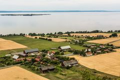 Swedish village on the lakeside - aerial. Small swedish village among summer fields on the waterside of lake Wetter - aerial view Royalty Free Stock Photo