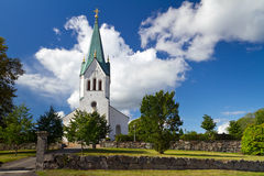 Swedish white church over sunny blue sky Royalty Free Stock Image