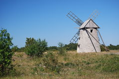Swedish windmill. View of an old stone working windmill on a bright sunny day in the Swedish countryside Royalty Free Stock Image