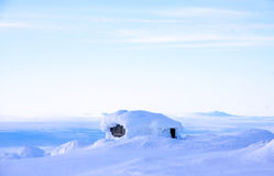 Swedish Winterhouse with a View. A small snow covered house on top of a mountain in Sweden Stock Photos
