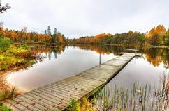 Swedish wodden bridge in autumn scenery Stock Photos