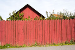 Swedish wood house and fence. Detail of typical Swedish wood house, with fence in the typical red 'falun' color Stock Image