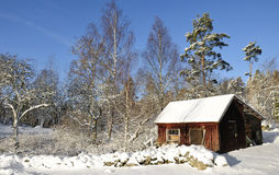 Swedish workhouse in snow. Old Swedish workhouse in december month Stock Images