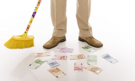 Sweep. Business man sweeping euro banknotes on the floor Royalty Free Stock Photos