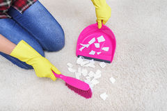 Sweep the carpet. Stock Photos