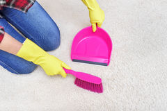 Sweep the carpet. Royalty Free Stock Photography