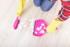 Sweep the papers on the floor. Royalty Free Stock Photo
