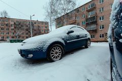 Sweep snow from the car in winter time lapse video. Sweep snow from the car in winter timelapse. men sweeps the snow from his car in the parking lot Royalty Free Stock Photos