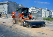 Sweeper attachments mini excavator. Royalty Free Stock Images
