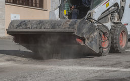 Sweeper attachments mini excavator. Royalty Free Stock Photos