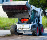Sweeper attachments mini excavator. Stock Images