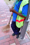 Sweeper and broom2. Street sweeper and his broom Stock Photography