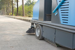 Sweeper machine on the Road. Blue Sweeper machine on The road Royalty Free Stock Photo