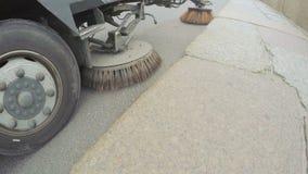 Sweeper machine on street stock footage