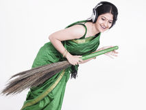 Sweeper singing with her broom Stock Photo