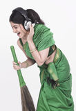 Sweeper singing into her broom Royalty Free Stock Photography