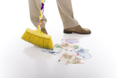 Sweeping. Man sweeping many euro banknotes on the floor Royalty Free Stock Image