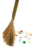 Sweeping. A new broom sweeping various debris and mud Stock Photography