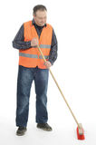 Sweeping. Sweeper man is sweeping with broom Royalty Free Stock Photo