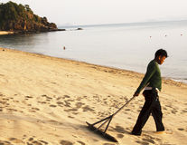 Sweeping the beach Stock Photos