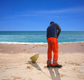 Sweeping the beach Stock Images