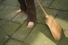 Sweeping with broomstick Stock Photography